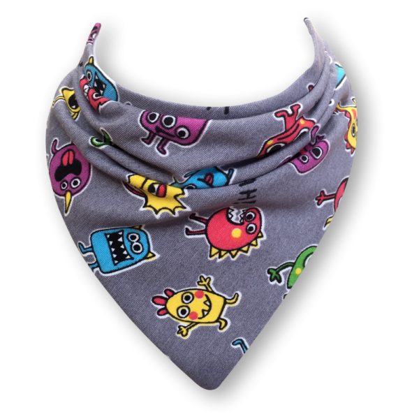 Grey dribble bib with images of cartoon monsters